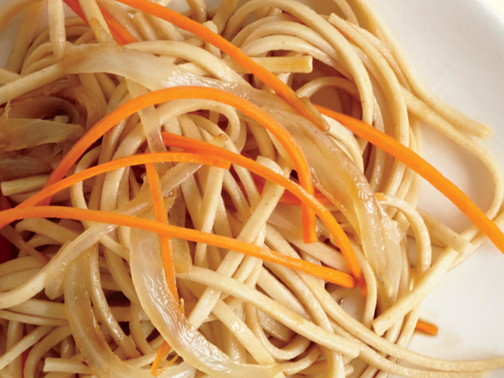 Udon is a thick Japanese noodle made of wheat flour. Serve with onion, garlic, and shredded carrot for a quick and easy side to chicken teriyaki or another Japanese-inspired entrée.