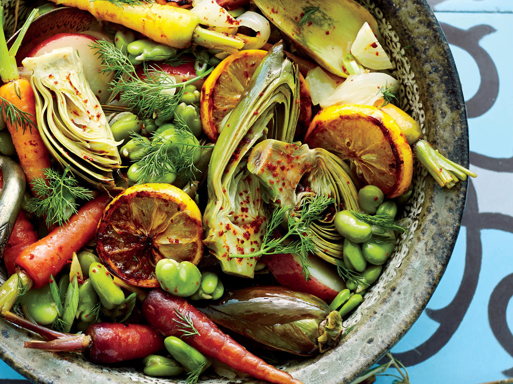 This is a kind of springtime Greek ratatouille. We love the artichokes in this dish—they add their unique flavor and somehow make everything taste just a little sweeter. The olive oil emulsifies with the braising liquid to create a silky sauce that deliciously coats the bright spring veggies. Thin lemon slices, charred and caramelized in a cast-iron pan, make a nice garnish.