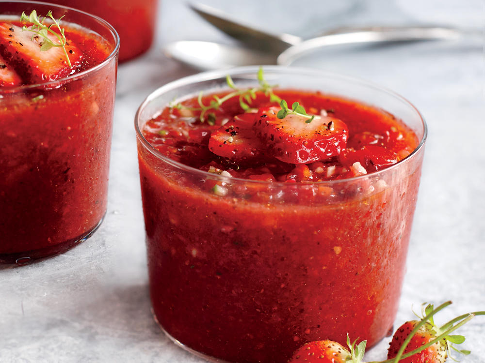While tomato season is at bay, turn to strawberries to make this refreshing version of the classic Spanish chilled vegetable soup.