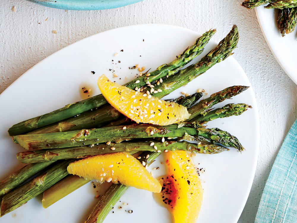 Fresh orange juice and a navel orange mixed with asparagus pack a powerful citrus punch.