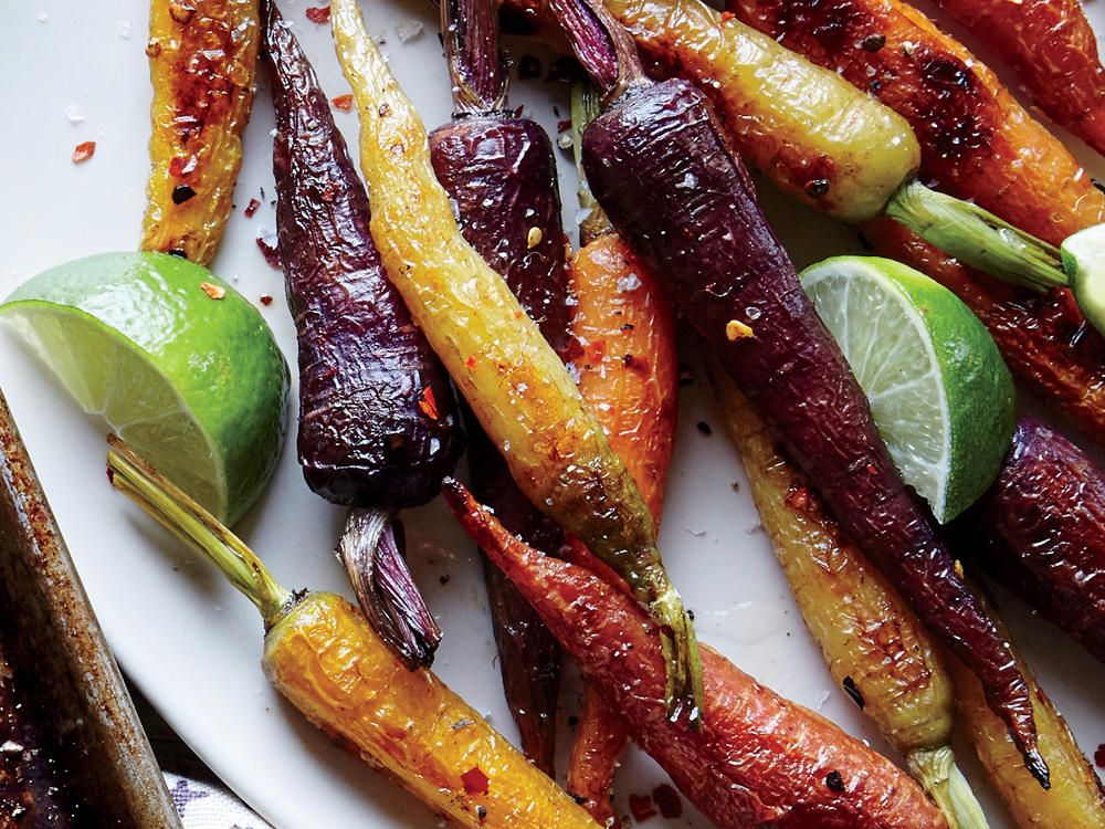 Give your classic roasted carrots a flavor boost with toasty chile and zesty lime.