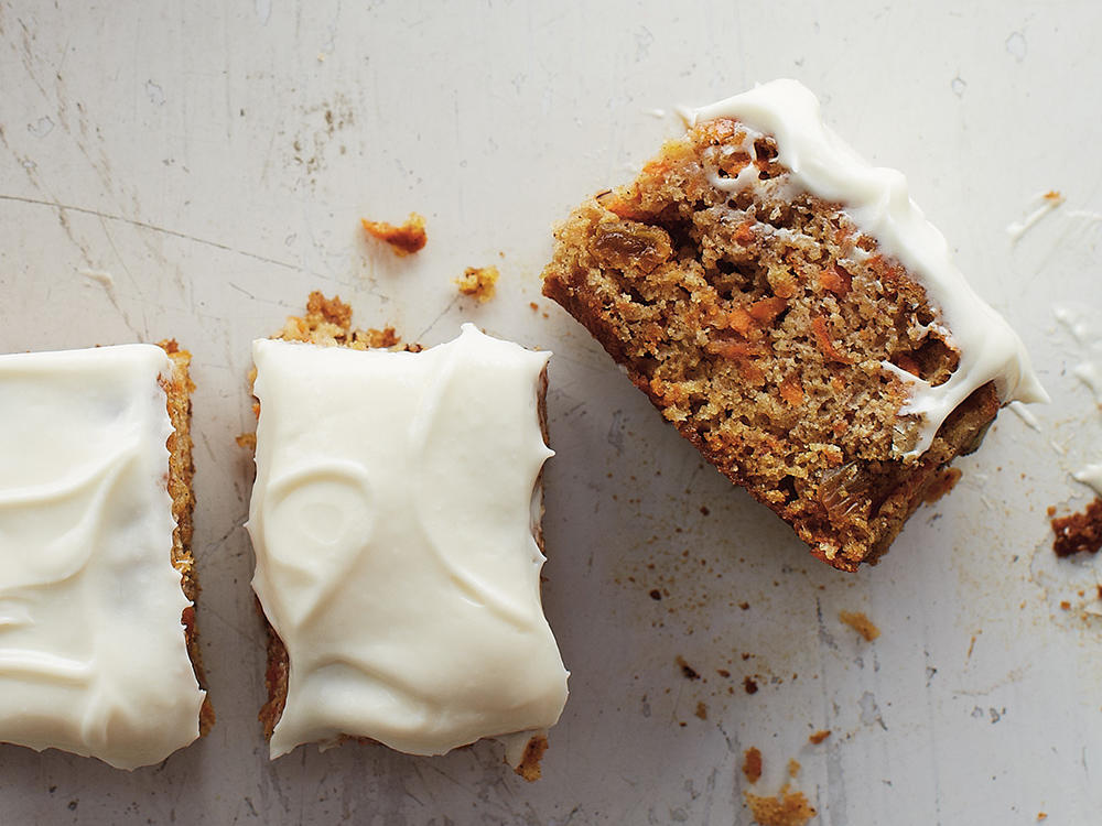 A smear of cream cheese frosting is the ideal topper for this warm spiced carrot cake.