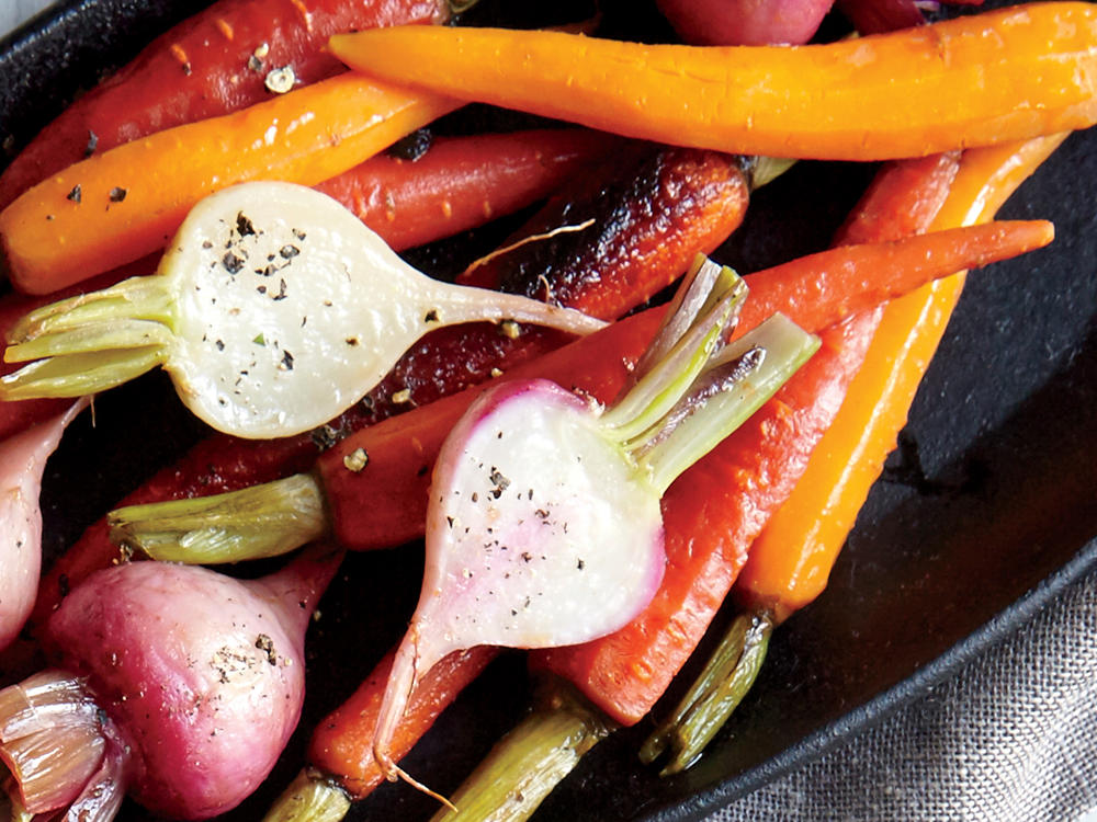 Wrap the vegetables in a foil packet so they steam gently and are easy to flip all at once. Place the packet right on the floor of the oven so the vegetables cook through quickly.
