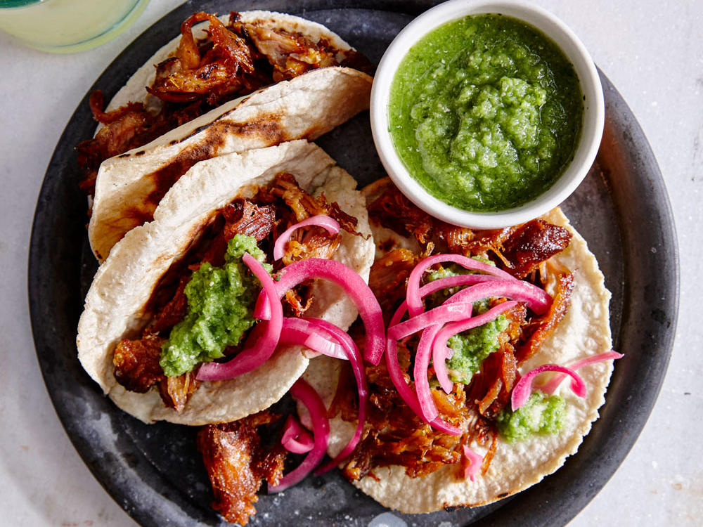 The pork gets a big flavor boost from achiote paste, a mix of ground annatto seeds, vinegar, salt, and spices. Find it at Latin markets.
