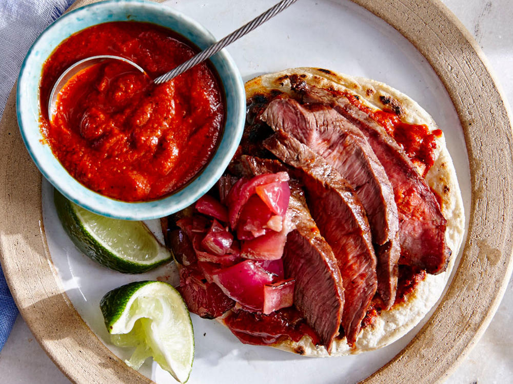 In Latin cuisine, a little bit of blistering on tortillas, peppers, onions, and garlic adds pleasant smoke and incredible complexity to a dish. The marinade for our Steak Tacos depends on this for bold taste that can stand up to the Toasted Chile Salsa.