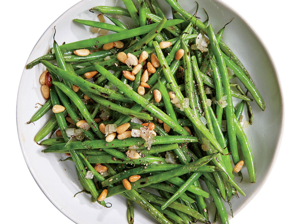 This simple side of French green beans, shallots, and pine nuts comes together in a snap.