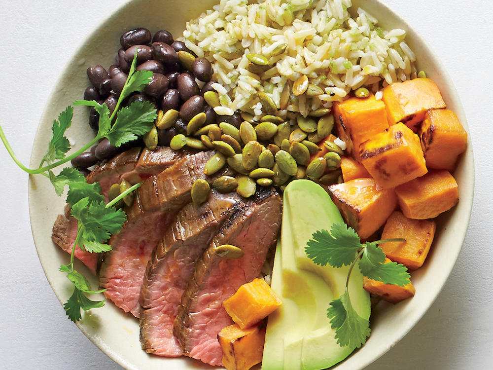 A little meat travels far since there's no center stage in a bowl. Here, a few ounces of Peruvian steak works wonders on top.Season well, and shred or finely chop to get a little in each bite.