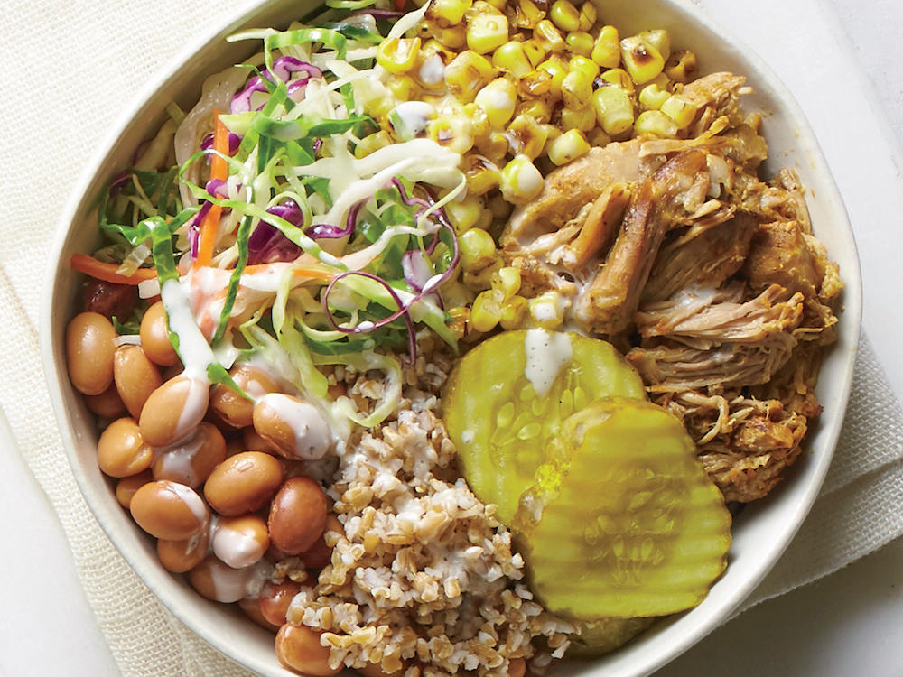 Bread-and-butter pickles, pinto beans, coleslaw andpulled pork unite for a true Southern twist, y'all.