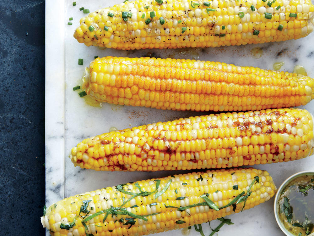 Nothing says summer like fresh corn on the cob. Here are a few of our favorite flavor combos for buttering them up: Corn on the Cob with Lemon-Curry Spice Butter, Corn on the Cob with Honey-Chipotle Butter, Corn on the Cob wiht Orange, Tarragon, and Basil Butter.