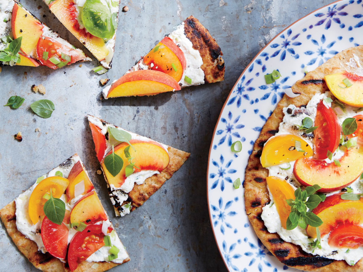 Grill the naan just until warmed through so the peaches and tomatoes stay juicy. Think of whole-grain naan as pizza crusts without the wait. Just throw on the grill and cook 2 to 3 minutes or until marked.