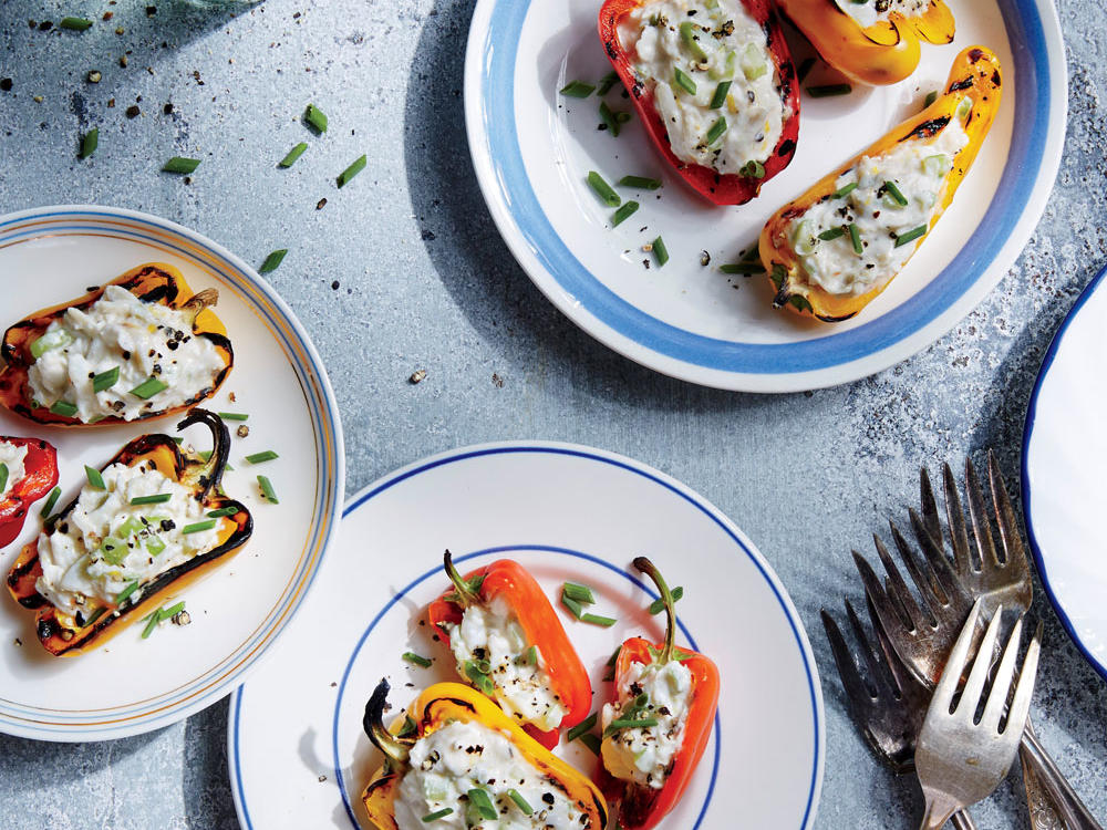 This fast appetizer combines stuffed mini bell peppers and creamy crab dip into one pretty, portable bite. Use multicolored peppers for extra pop.
