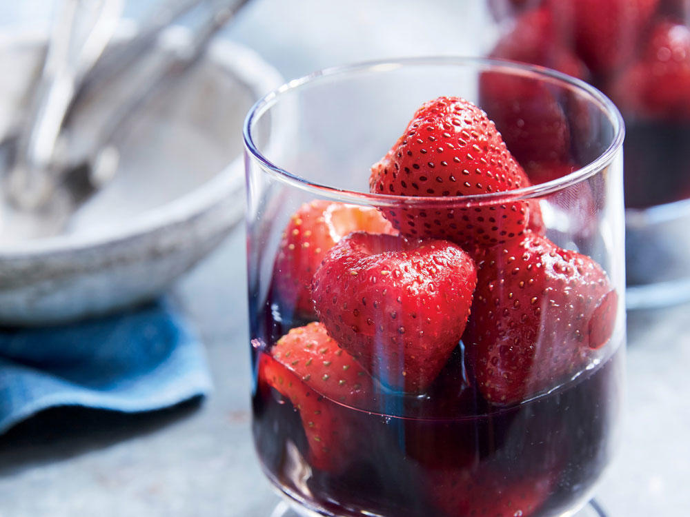 In Bordeaux, where châteaus and vineyards abound, a typical dessert is fresh strawberries sliced into a red wine glass and then topped with a great Bordeaux. Here, that regional tradition is adapted to make it more dessert-like. If you're pressed for time, do as the Bordelais do—quick and easy.