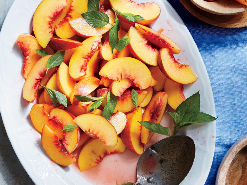This dish is all about the fragrant orange flower water. Look for it in Mediterranean markets or speciality supermarkets. At farmers' markets, you can find peaches whose flesh is nearly red, their skin fragile and lightly furred, their flavor intensely perfumed and deep. This recipe, which couldn't be simpler, exemplifies the most important tenet of all French coking—when you have fabulous ingredients, get out of the way and let them speak for themselves. Chilling the peaches makes them easier to slice nicely and gives a refreshing edge to their flavor.