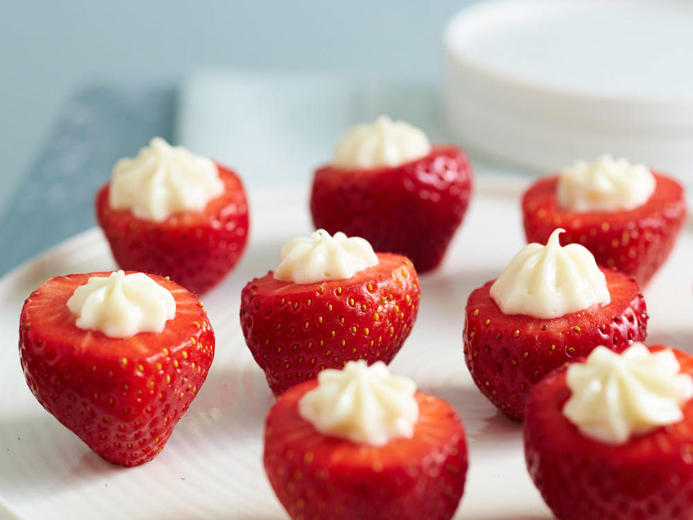 A simple mixture of powdered sugar, cream cheese, and amaretto transforms hollowed out strawberries into an ultra simple dessert or appetizer—perfect for spring gatherings.