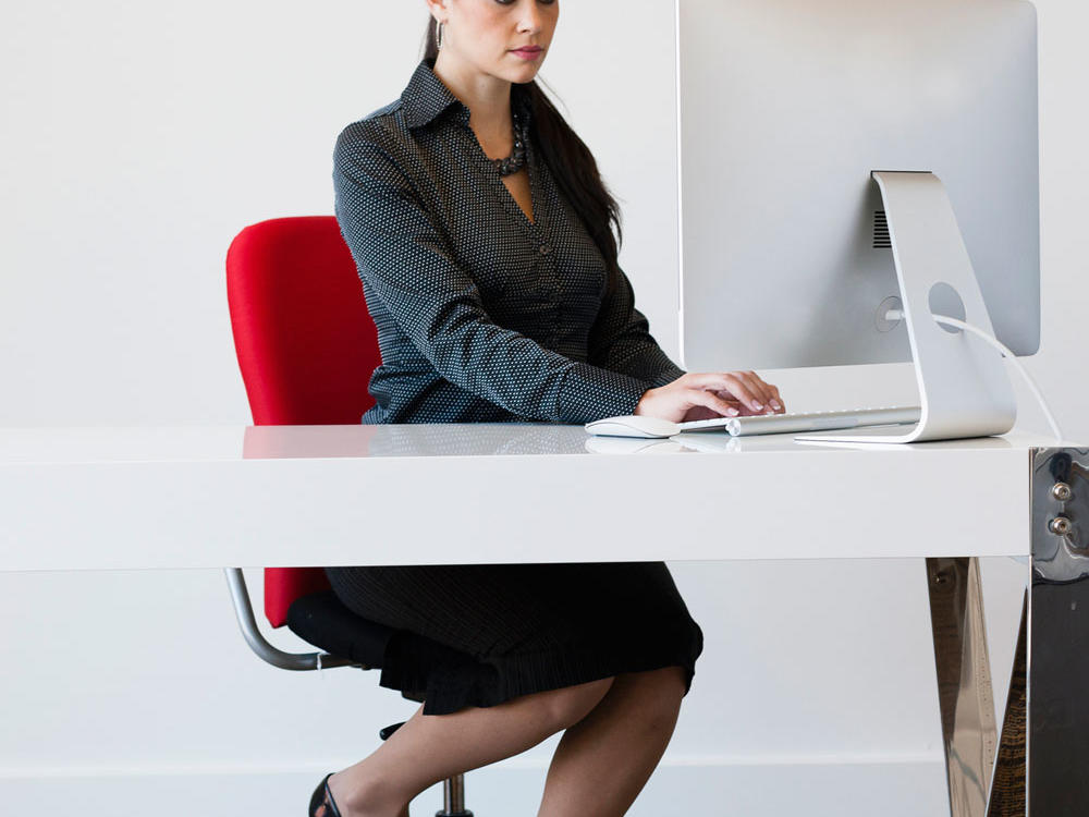 If you're stuck in front of your computer, don't fret—isometrics are a great way to get in a quick workout without leaving your chair. Squeeze your glutes and hold for 5 to 10 seconds, then repeat until exhaustion. Or, place your hands behind your head and push backwards to engage your neck muscles.