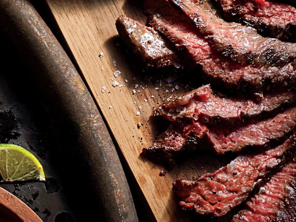 Carne asada is the quintessential grilled dish of Mexico. At its best, it's the stuff dreams are made of. Nonetheless, it has come a long way from its origins in northern Mexico. Consider this recipe a way of preserving what carne asada really stands for: juicy, smoky, heavenly steak.