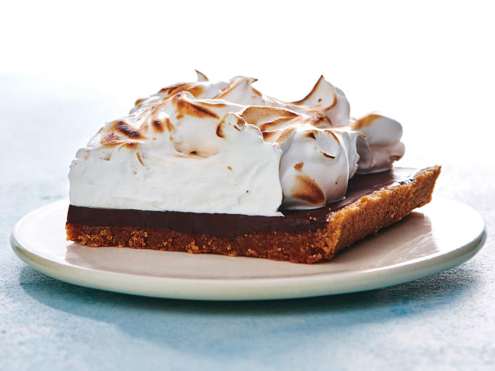 This summertime treat is perfect for a potluck. They are great served at room temperature, but if you want, pop the pan into a warm (250°) oven for 2 minutes just until the chocolate softens for the full gooey experience. For a fruity twist, place thinly sliced bananas over the chocolate layer before adding the meringue.