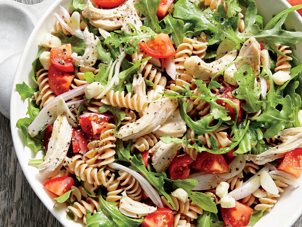 In this dish, just a bit of a rich and pungent cheese can go quite a long way. Tossing hot pasta with a few ounces of creamy Brie makes for a light, luscious, and flavorful sauce to coat this abundant bowl of chicken, fresh veggies, and whole-grain noodles.