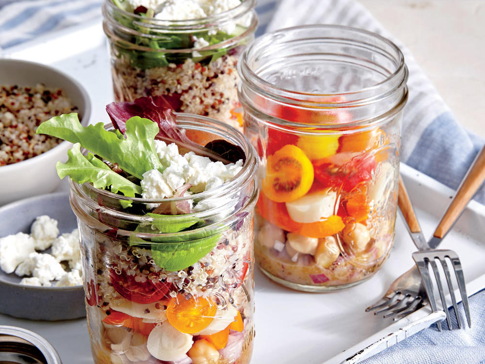 Layer a colorful salad in portable glass jars. Kids will give it a thumbs-up. Make these salads up to a day ahead; pack them tightly with the dressing on the bottom, followed by denser ingredients that won't get soggy while they marinate. Customize with your favorite seasonal veggies, fresh cheeses, and whole grains. These make great additions to lunch bags, picnic baskets, or road trip coolers and can easily double if you need lunch for 4 people.