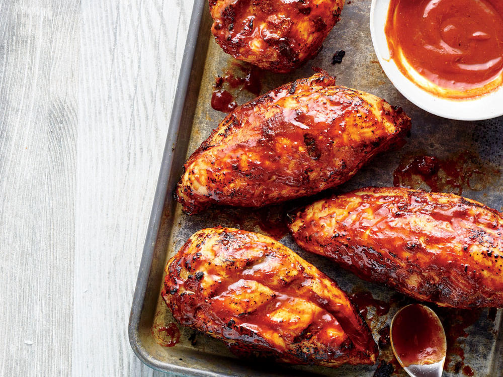 This chicken is wonderfully moist, with a smoky sauce that will have you firing up the grill year-round. In our ultimate BBQ makeover, we remove the skin just before the chicken finishes grilling (saving 128 calories and 2.7g sat fat per breast), then baste with a spicy-sweet sauce. The best part? You'll save 183 calories, 3g sat fat, 26g sugar, and 854mg sodium over the traditional recipe, without losing any of the flavor.