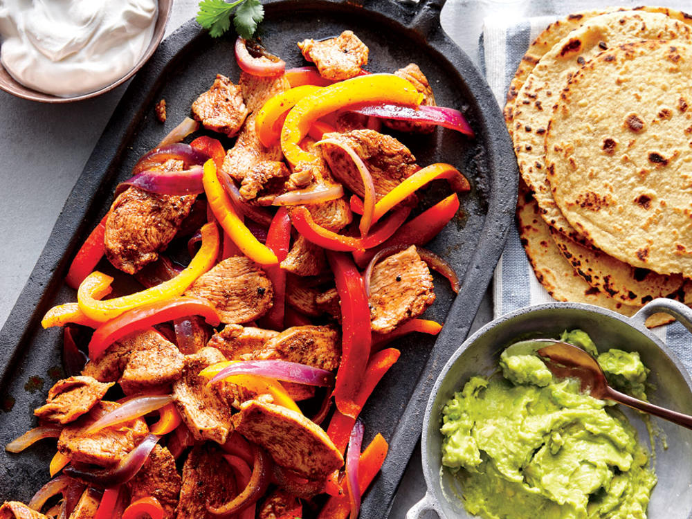 For a casual, fun get-together, set up a make-your-own-fajitas bar with the chicken filling, avocado cream, sour cream, and any other toppings you love—such as pico de gallo, sliced fresh jalapeños, or crisp radish slices. The recipe serves 4, but you can easily double it to feed a larger crowd. For a quick, easy side, combine shredded red or green cabbage, toasted hulled pumpkin seeds (pepitas), and crumbled queso fresco. Toss with a simple dressing of lime juice and olive oil.