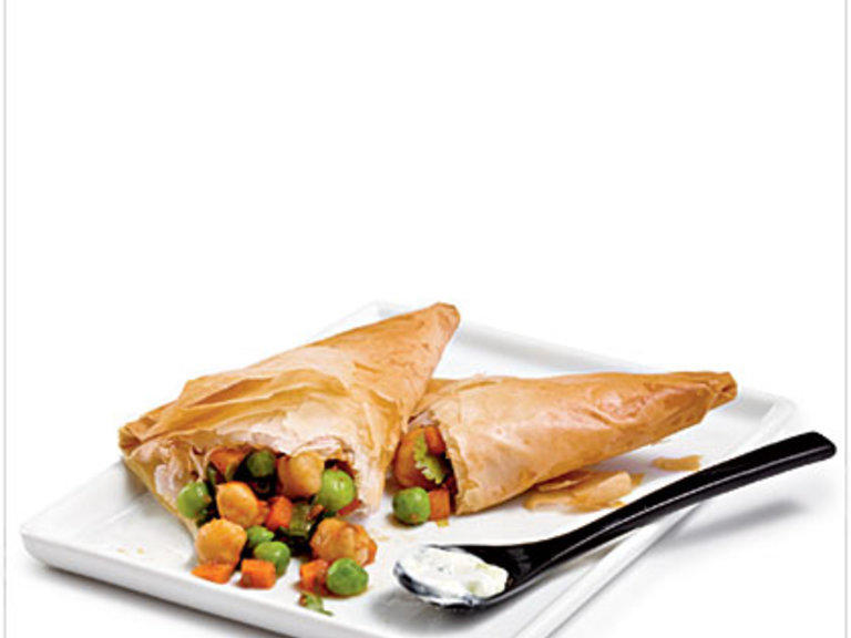 The preparation is worth it for these crispy and flavorful samosas. The combination of spice with buttery, flaky phyllo dough pairs well with the cold, tangy raita.