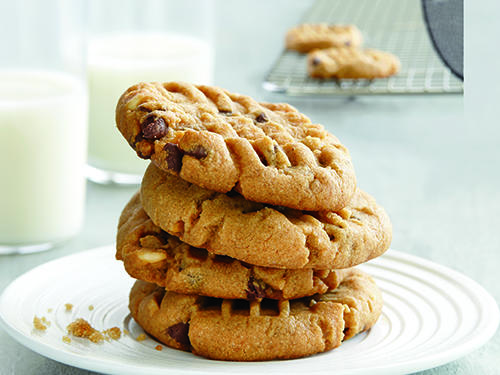 You probably have everything on hand to make these chewy, chocolaty peanut butter cookies. To fit the cookies on a single sheet pan, divide cookies into 5 rows of 4. Pressing the cookies flat helps them bake quickly and get lovely crisp edges; otherwise they'll be too round and undercooked.