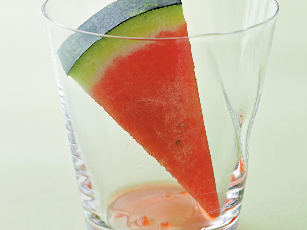 A slice of watermelon in a drinking glass