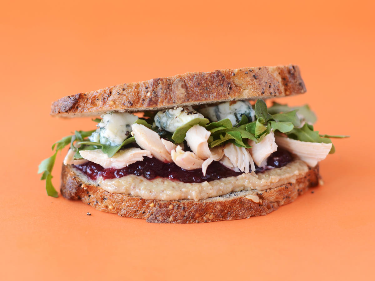 Cran Turkey Greens and Walnut Butter Sandwich