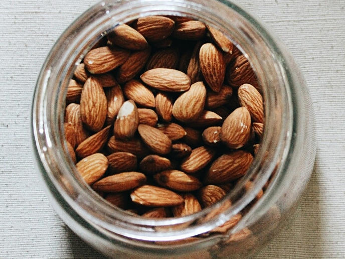 Protein: 6 grams per ounce                                                      Go nuts over almonds—the monounsaturated fats they contain have been shown to reduce heart disease. A serving size is about one handful of almonds, or 2 tablespoons of almond butter. Try sliced almonds on top of salads or create your own spiced recipe to liven them up a bit.