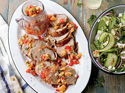 This recipe opens up a myriad of dinner and lunch possibilities. Serve it grilled and topped with the cantaloupe–red pepper salsa, as we do here, or save it (or the leftovers) for sandwiches. You can also serve the meat thinly sliced and cold over a bed of mixed lettuce greens and slices of fresh peaches drizzled with lime juice and olive oil. Pancetta is an Italian bacon and, like American-style bacon, is made from the pork belly; unlike bacon, it isn't smoked. Instead, pancetta is cured with salt and spices. You can find pancetta in Italian food markets and at many grocery markets. If you wish, you can substitute American-style bacon, but be aware that the smokiness of the of the bacon will translate into the overall dish. For a shortcut, purchase prepared fresh salsa from the market and augment it with diced cantaloupe. Add in jarred roasted red pepper too if you wish.