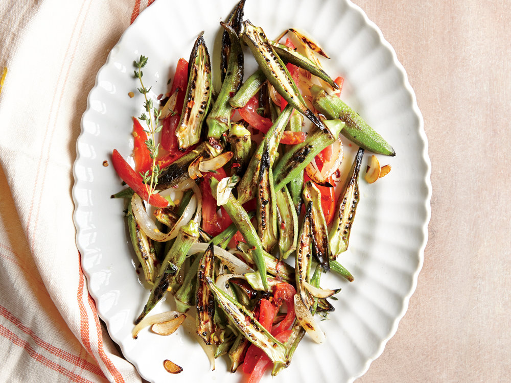 Even folks who aren't okra fans will be swayed by this dish. The key is in the high-heat sear, which cooks off much of the mucilage that makes okra unappealingly slippery for some. A screaming-hot pan (use a well-seasoned cast-iron skillet if you can) puts a delectable char on the pods, lending smoky flavor and crisp texture. With sweet-tart tomato, fragrant garlic and onion, and just enough butter to amp up flavor and lend a touch of richness, this dish becomes a crowd-pleaser that may just make an okra lover out of you.