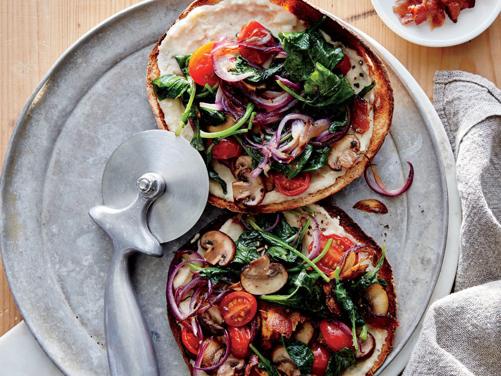 Not just for stuffing, pitas are an instant pizza base and your all-purpose bread for breadcrumbs. For a satisfying vegetarian main, omit the bacon; instead, sauté the vegetables in 2 teaspoons olive oil, and sprinkle pizzas with 1 ounce shaved Parmesan cheese for a hit of salty, savory flavor.