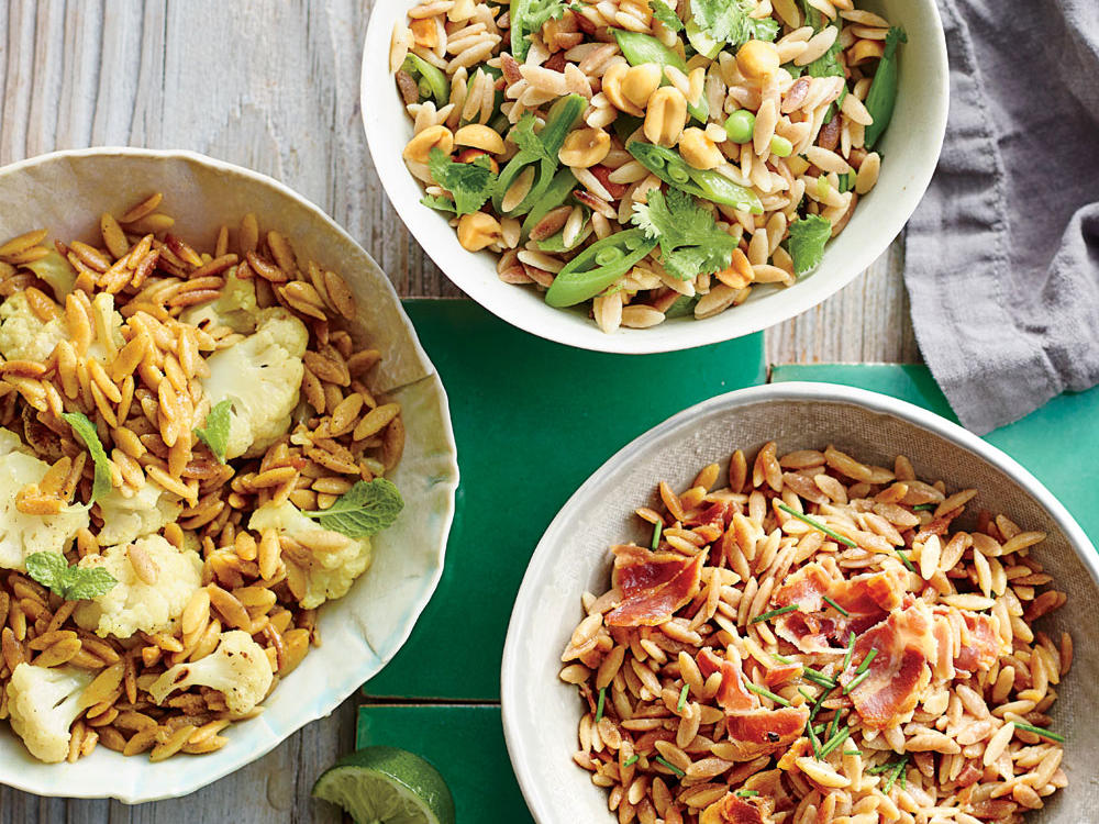 This trio of fresh sides comes together easily and pairs with a variety of main dishes. Our Orzo with Curried Cauliflower and Mint pairs great with grilled protein and can stand alone for a hot or cold lunch. Using the recipe as a base, add any vegetables of your choosing such as zucchini, onions, eggplant and fresh herbs to brighten your pasta salad. Toasted nuts are also a great addition and add a new texture. Orzo with Snap Peas, Cilantro, and Peanuts boasts quick sautéed sugar snap peas, earthy chopped cilantro, tangy rice vinegar, and buttery peanuts. Add shredded chicken or sautéed shrimp with lemon to make this dish a one-pot meal. Finally, in our Orzo with Crispy Pancetta and Chives, whole-wheat orzo soaks up the salty and buttery flavor of sautéed pancetta. Pair with grilled fish.