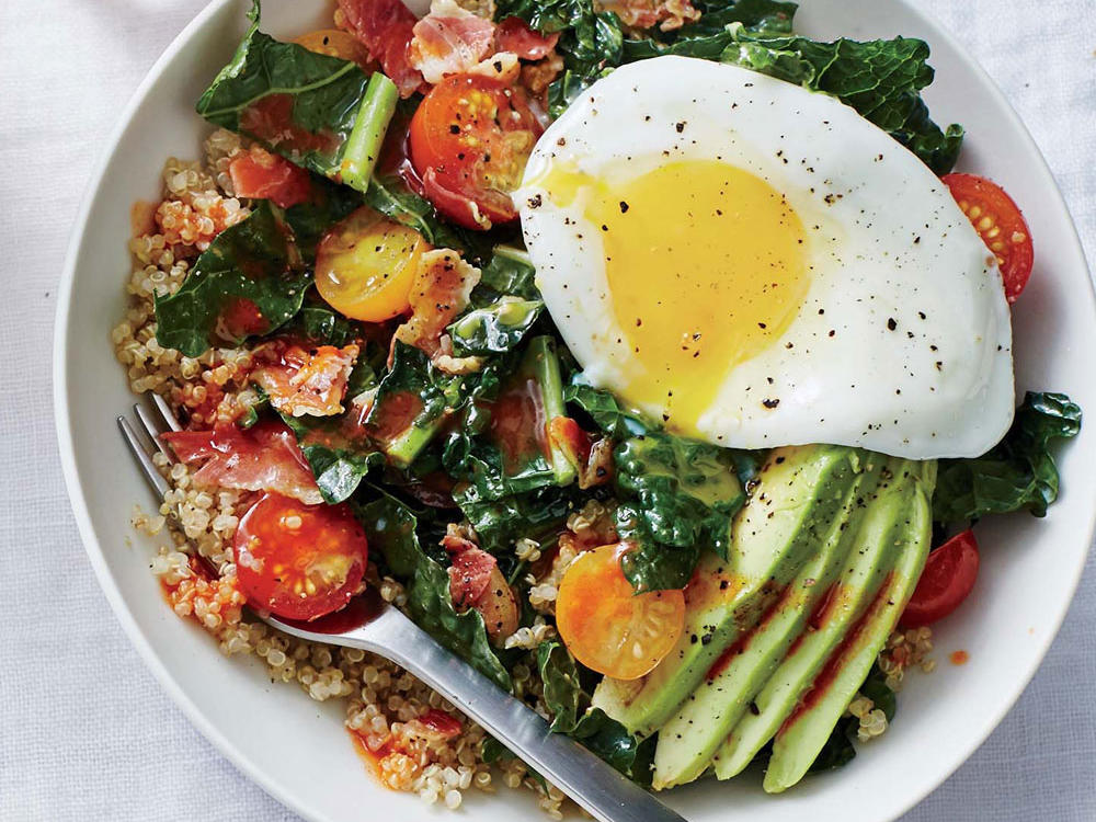 Here, the yolk of the fried egg serves as a dressing (without you having to do anything extra) to coat nutrient-dense quinoa. Pancetta adds a snap of savory satisfaction to earthy kale, while all-season cherry tomatoes, meaning you can make it whenever, lend a fresh pop of bright flavor. Sub steel-cut oats, bulgur, or leftover brown rice for quinoa. The hot sauce gives this simple dish a kick in the pants.