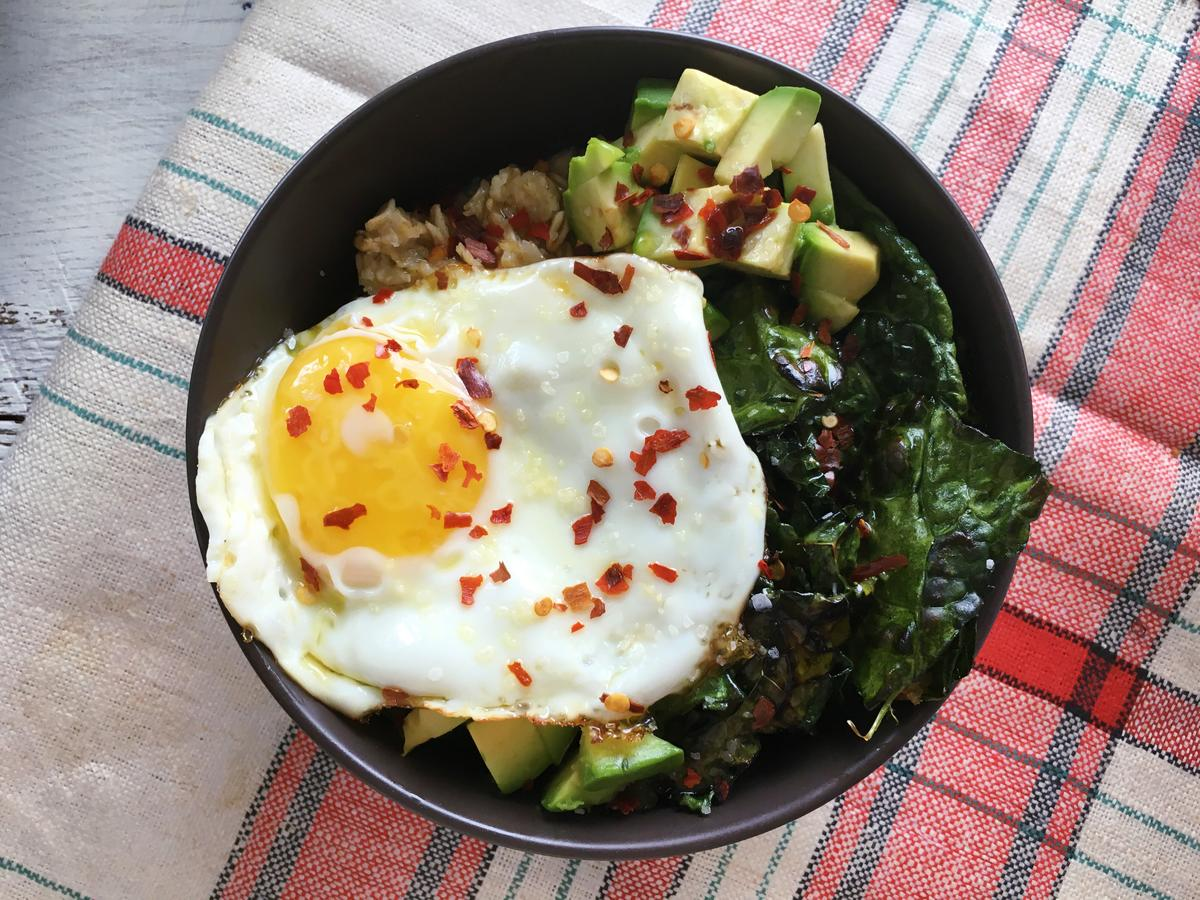 Kale, Avocado, and Fried Egg Oatmeal Bowl image