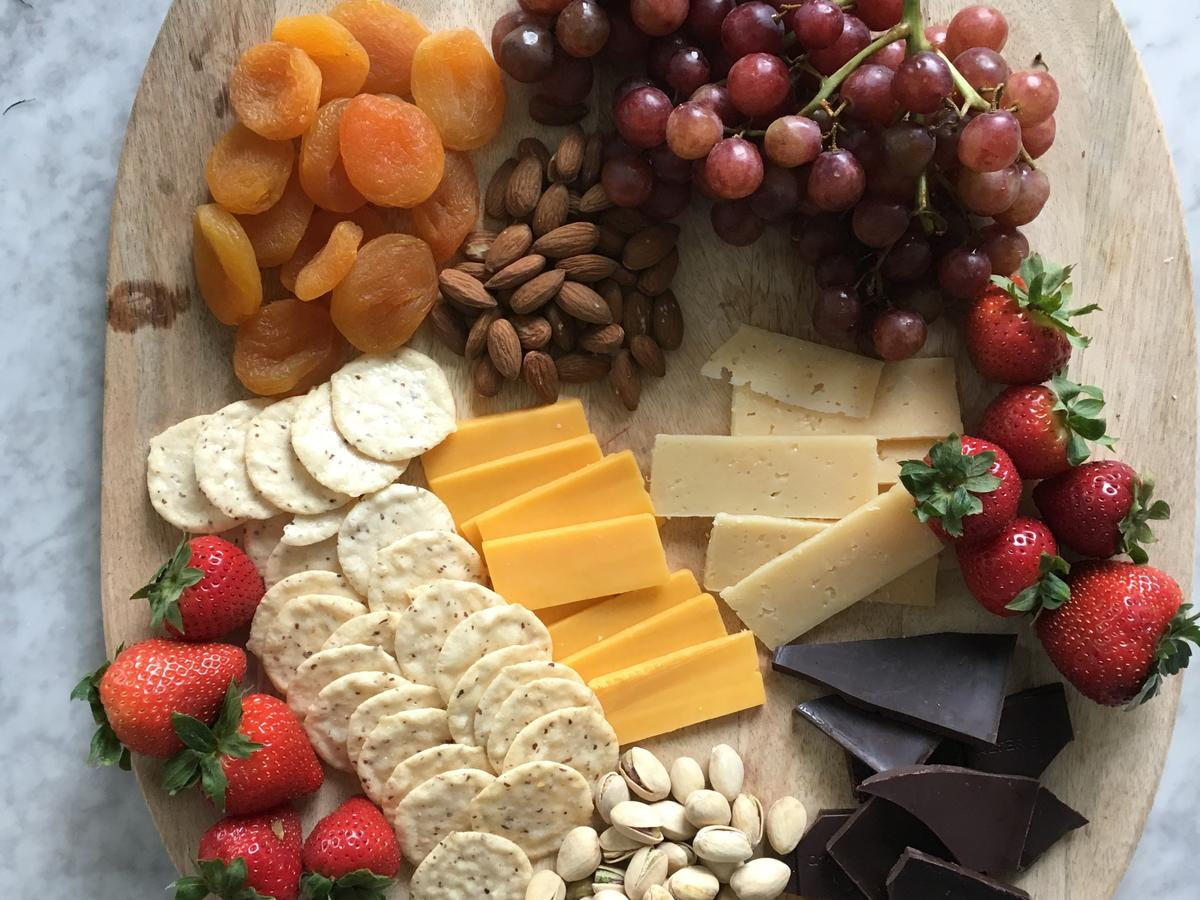 Enjoy this spread for an afternoon snack or late-night dessert. Nuts and cheese pack in the protein while the fruit and chocolate add just the right amount of sweetness to satisfy your cravings. Not only does this cheese board pack in protein, there is over 390mg of calcium per serving thanks to the cheese, almonds, and chocolate. 
