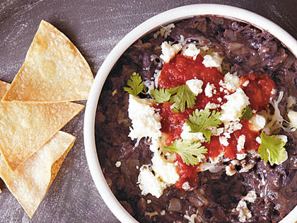 A common craving among CookingLight.com users is chips; our homemade tortilla chips keep fat and sodium in check. This snack quells an oft-cited yearn for Mexican fare and has protein, complex carbs, and fiber.