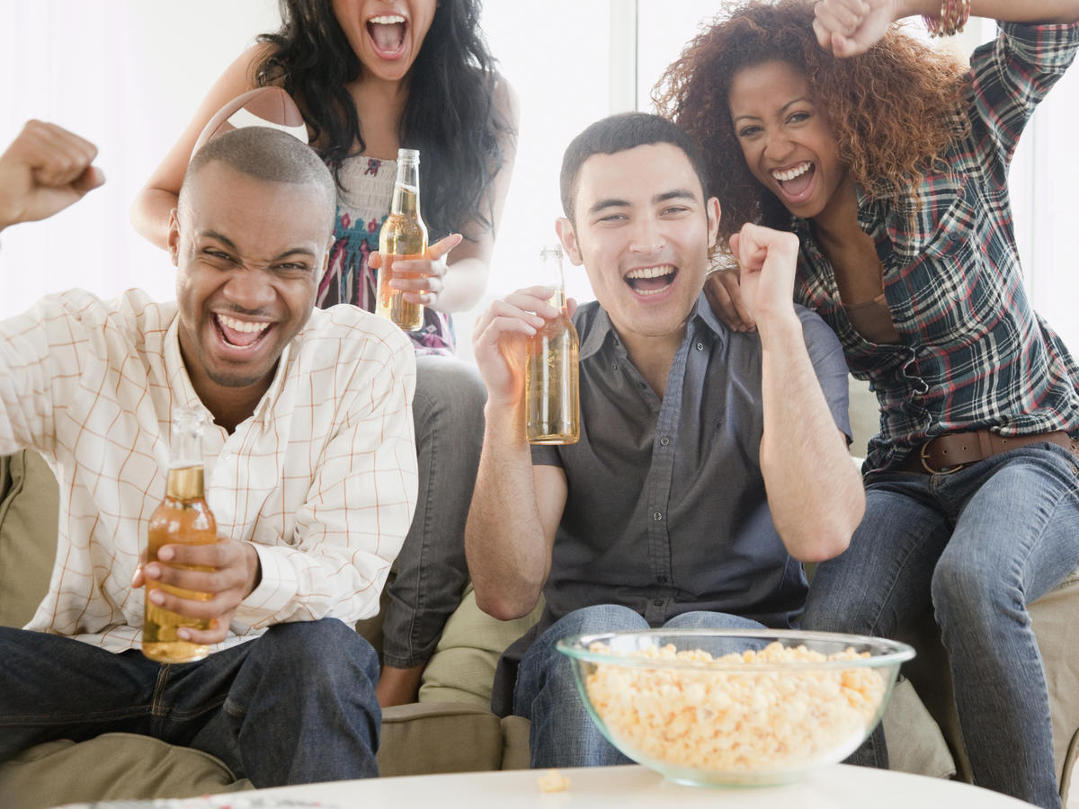 friends drinking beer watching television
