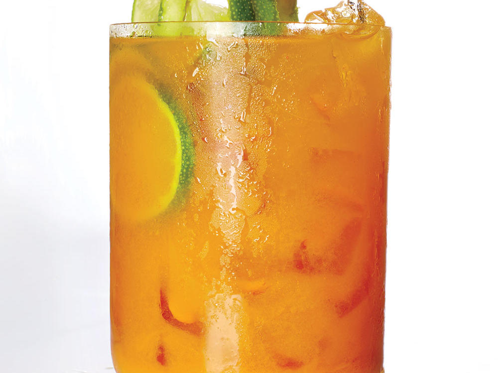 This is a twist on a Dark and Stormy, the classic dark rum and ginger beer combo. Turmeric gives this zesty cocktail its pumpkin-colored hue. If you don't have fresh turmeric, substitute 1 teaspoon ground turmeric. Lime boosts the tartness of turmeric to make a delightfully refreshing beverage. Myer's Rum is easy to find, but there are many small-batch dark rums now on the market; you may want to experiment with their subtle nuances.