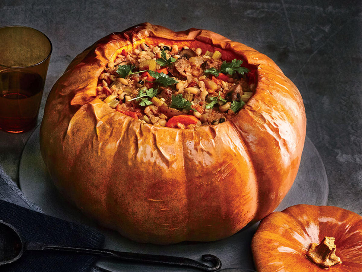 In this recipe, pumpkin plays a triple role: cooking vessel, serving bowl, and part of the meal itself. Choose a Long Island Cheese pumpkin for its creamy flesh or a Cinderella pumpkin. The hearty stew simmers inside the pumpkin while the flesh cooks and softens. Berbere, a peppery Ethiopian spice blend, richly seasons the pumpkin and stew. Find it at specialty markets or online at penzeys.com.