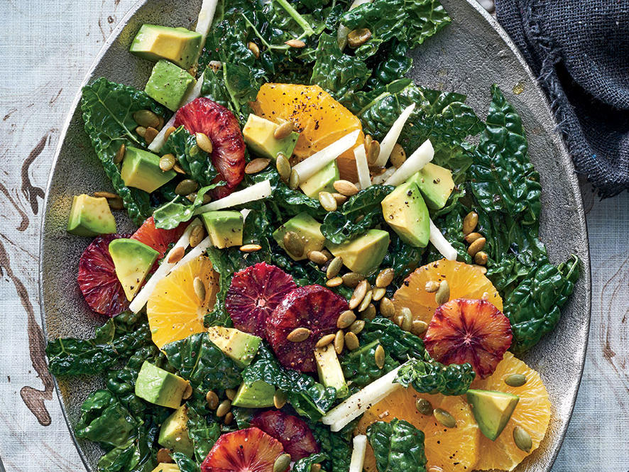 Bland veggie trays tend to lose out over sugary treats; serve this dish instead. This salad pops with color and texture from juicy citrus, creamy avocado, and crisp jicama. Dark, bumpy kale fits the mood, but you can substitute any lettuce you like. We love the pink hue of Cara Cara oranges in the salad, but regular navel or even blood oranges (in keeping with the spooky theme) would also work. Sturdy lacinato kale will become perfectly tender when dressed and left to stand at room temperature. Coating the avocado in the dressing first will keep it from browning while you're out having fun.