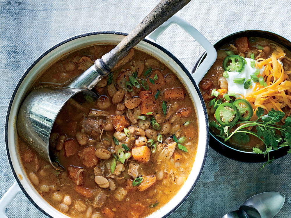 Get the chili started in the morning and keep warm in the slow cooker while you're out. Calling for a mixture of beans and hominy, this recipe boasts bold, rich flavor, something that can often be dulled in a slow cooker. Whirring some of the beans in a food processor thickens the soup, lending a heartier texture to the dish. We suggest serving the soup with green onions, cheese, cilantro, peppers, and plain yogurt, a great substitute for sour cream. Serve with Cheesy Jalapeno-Sour Cream Corn Muffins (next slide).