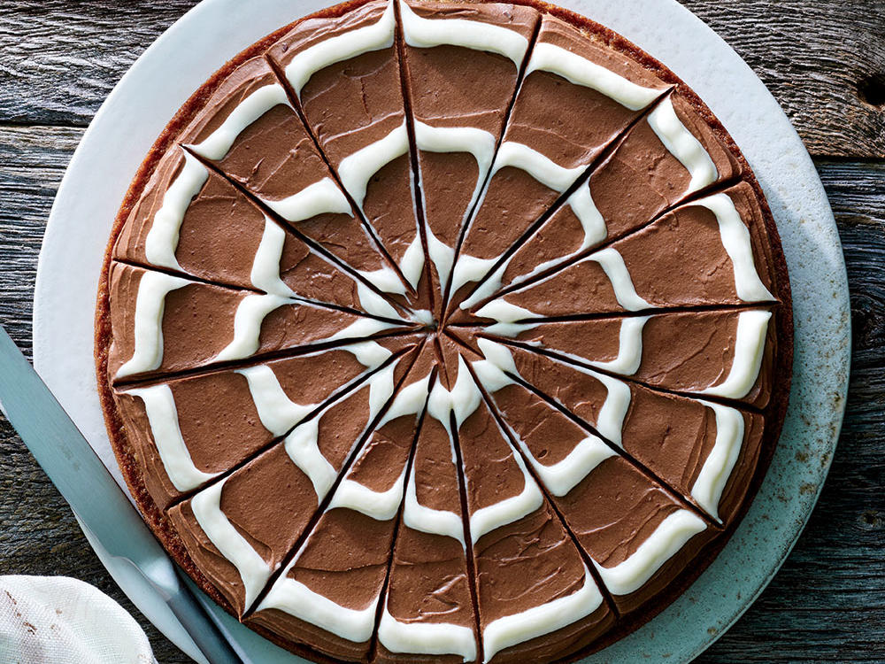 This festive fall dessert became an instant staff favorite. Brown butter imparts a rich flavor to blondies composed of bittersweet chocolate and cream cheese. A plastic zip-top bag makes it easy to pipe the web pattern onto the frosting.