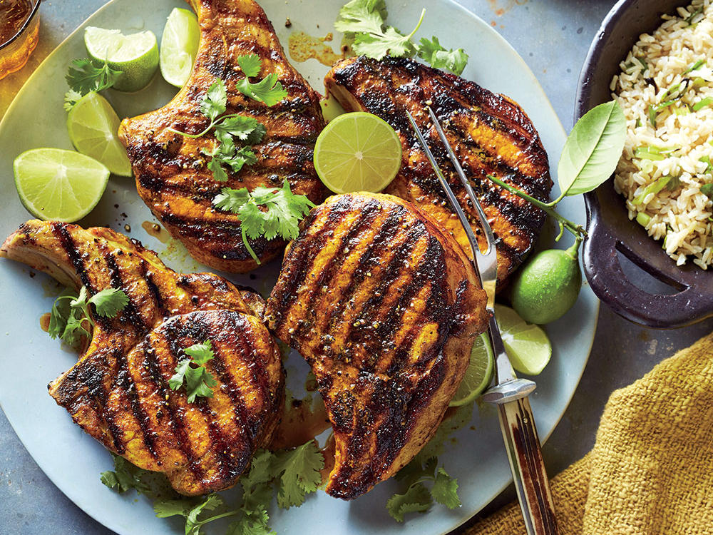 Our turmeric slathered pork chops may look polished, but don't let this quick weeknight supper fool you. It's complex flavor belies it's simple preparation.