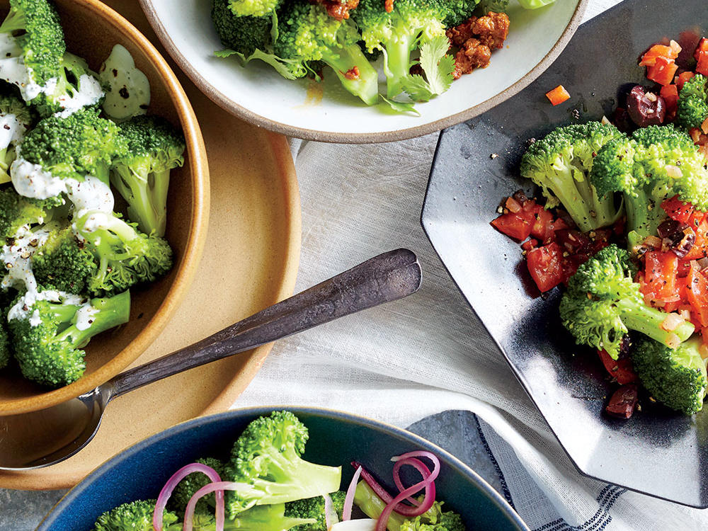 Broccoli is a go-to veggie side for many families yet is often served very plain. Here we offer 4 great ways to dress it up. First, we mix it with garlic and red onion for Mediterranean flavor. Next, we drizzle it with a creamy tarragon dressing composed of sour cream, milk, tarragon, and white wine vinegar. Then, we sprinkle it with Mexican chorizo for a hint of spice, and finally, we top it with a tomato ragout.