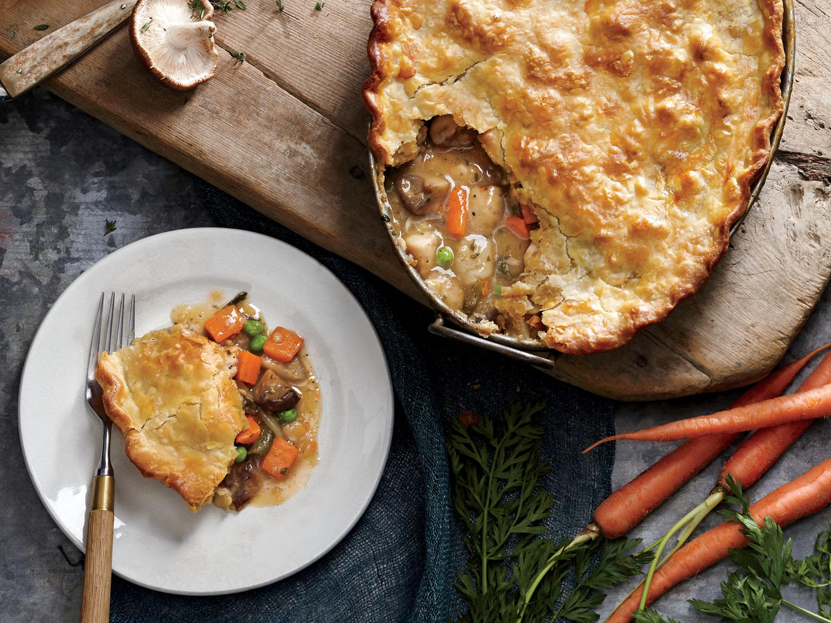 This homey and healthy chicken potpie boasts a creamy, savory sauce you'll want to lick from the pan. It's a flavor experience that often relies on several hours of slow cooking, but we've sped it up with a few shortcuts that still deliver on flavor satisfaction. For example, refrigerated pie crust dough is used in place of homemade dough. Potpie is a great way to use up leftover chicken or turkey, and that'll shave a few minutes off your cook time, too. Just skip step 2, add chicken to a warmed Dutch oven, and start the recipe at step 3. Thickening the sauce in the pan before the pie goes into the oven results in a luscious sauce that's begging for a swipe with crusty bread.