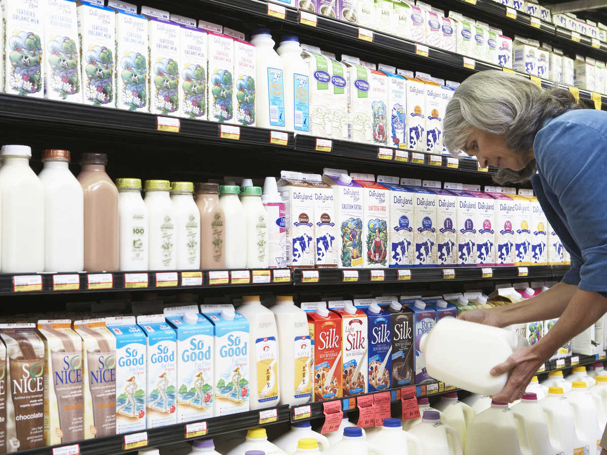 Woman Picking Dairy Aisle Milk