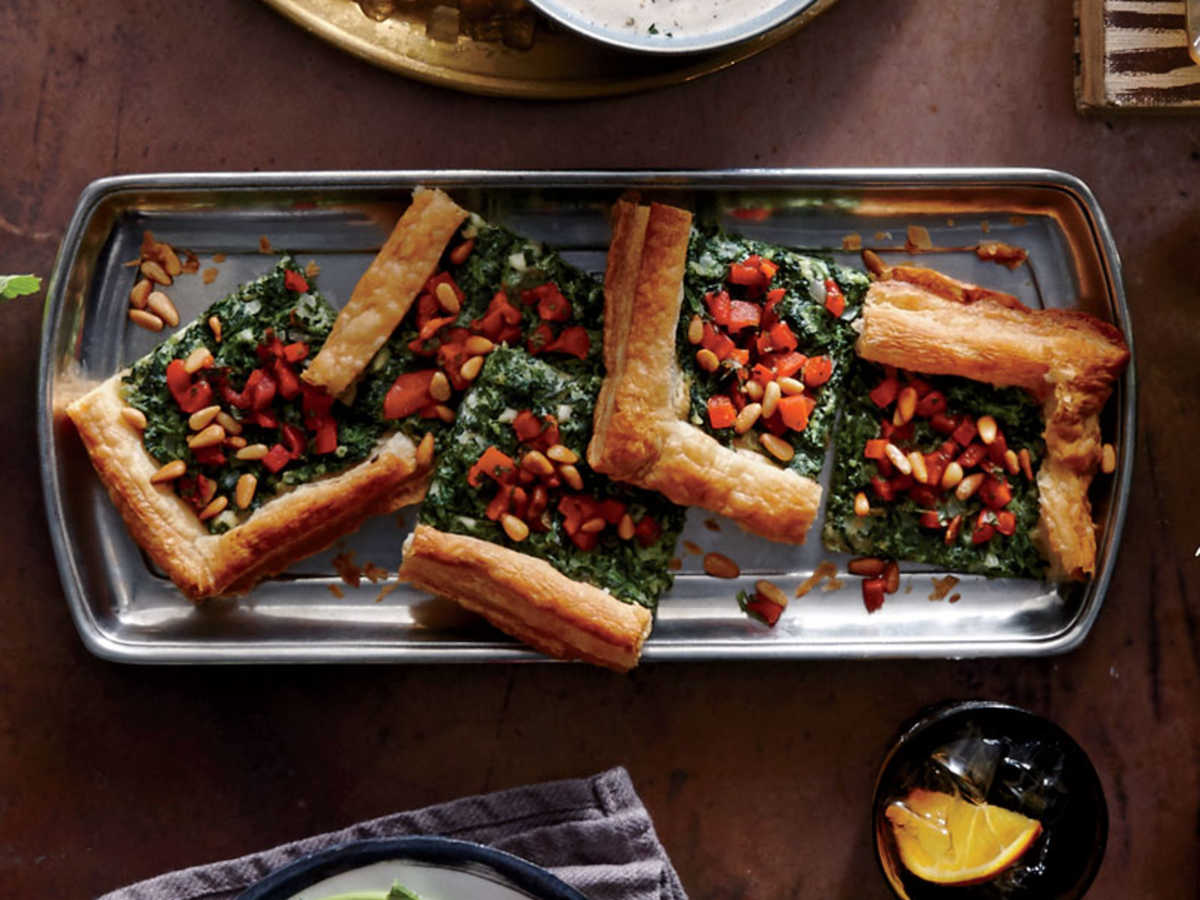 We use the tart-shell method from the master recipe for a fuss-free version of the classic Greek spinach-and-cheese-pastry. A little pimiento, brightened with vinegar, adds pop; you could also sub chopped olives. Make sure to drain the spinach mixture well; extra liquid could make the crust soggy. Let the spinach drain while the crust bakes. Build and finish baking the tart shortly before guests arrive.