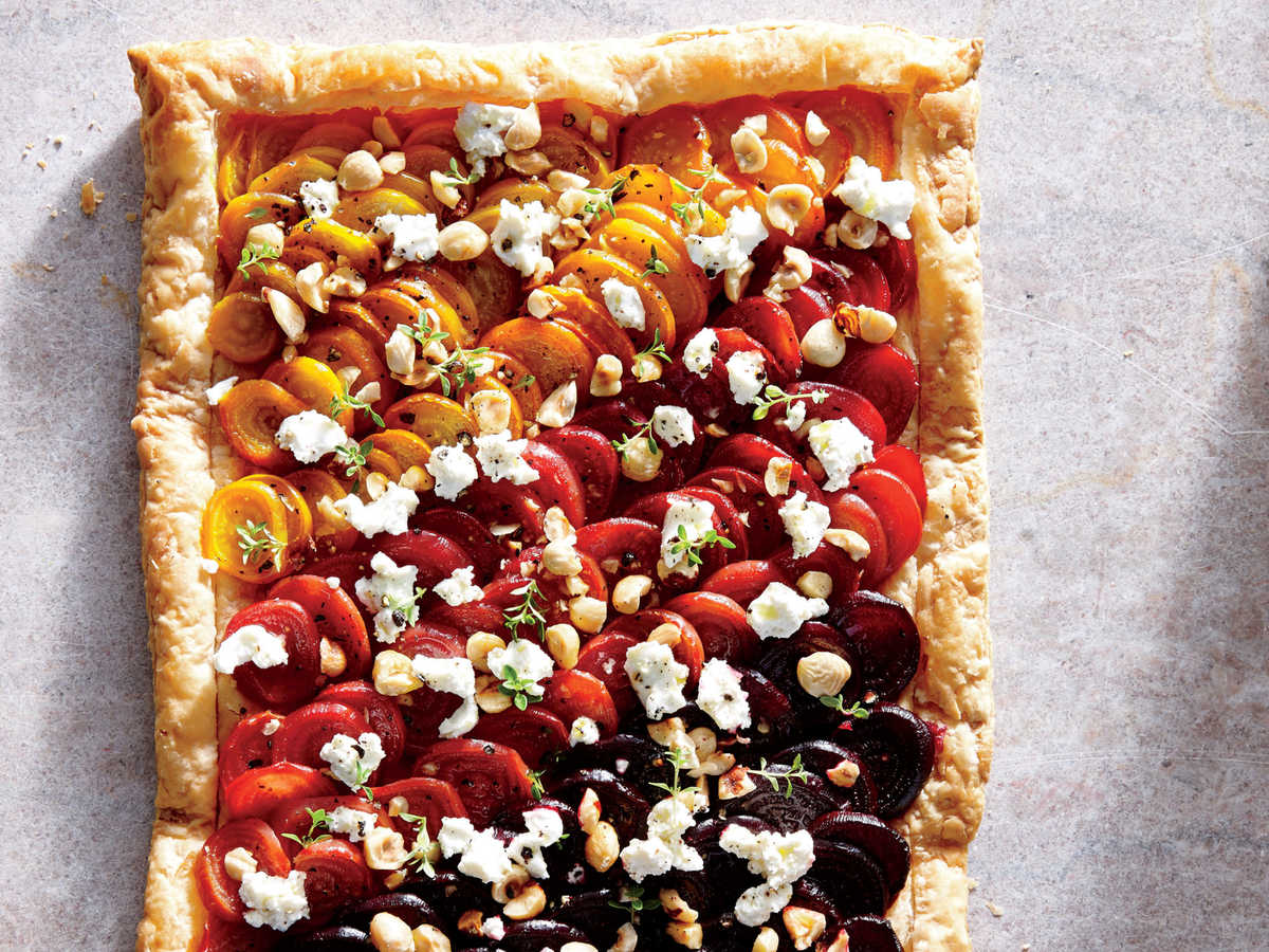 Start your holiday meal with a simple yet gorgeous beet tart, topped off with tangy goat cheese, crunchy hazelnuts, and flaky sea salt. Par-bake the crust to get a lovely raised edge (what forms the shell of your tart) and ensure that the bottom will be cooked through. If you or your guests are not beet fans, substitute sweet potatoes: Wrap 4 (4-ounce) sweet potatoes in parchment paper, and microwave at HIGH 3 minutes. Then cool, peel, and slice. You can also sub feta for goat cheese and pecans or walnuts for hazelnuts.